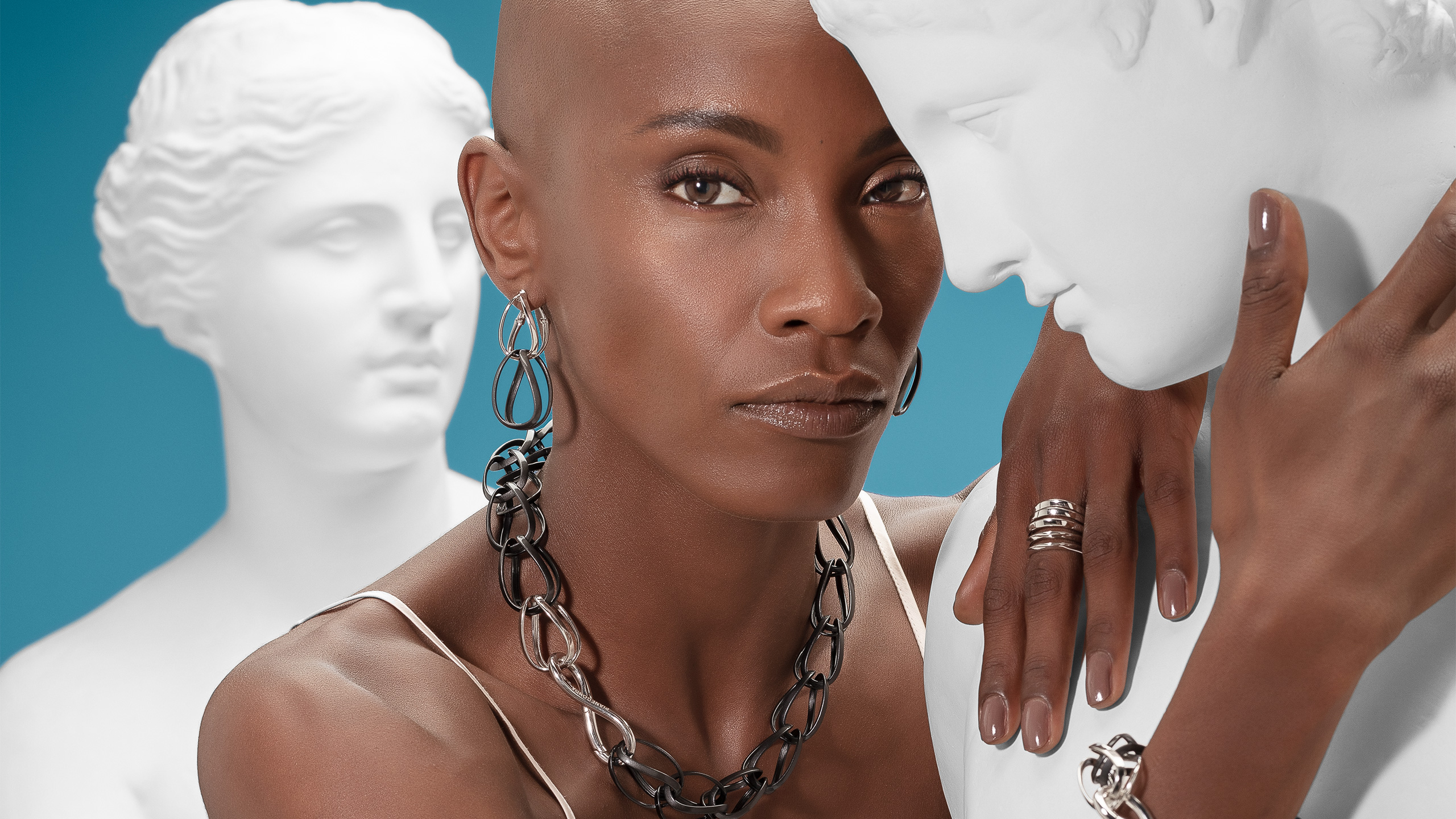 black woman with black necklace, black earrings and ring from Tecum collection